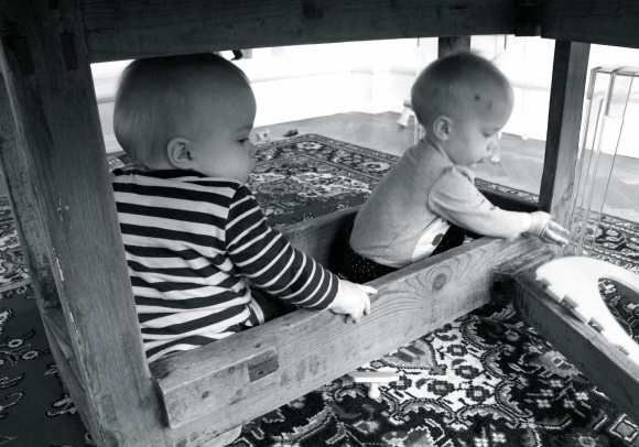 Hugo and Lilly under table