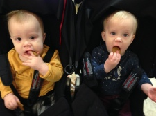 Twins eating gingerbread