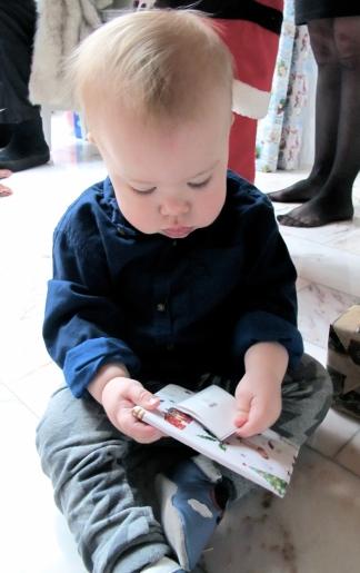 Hugo opens Christmas present